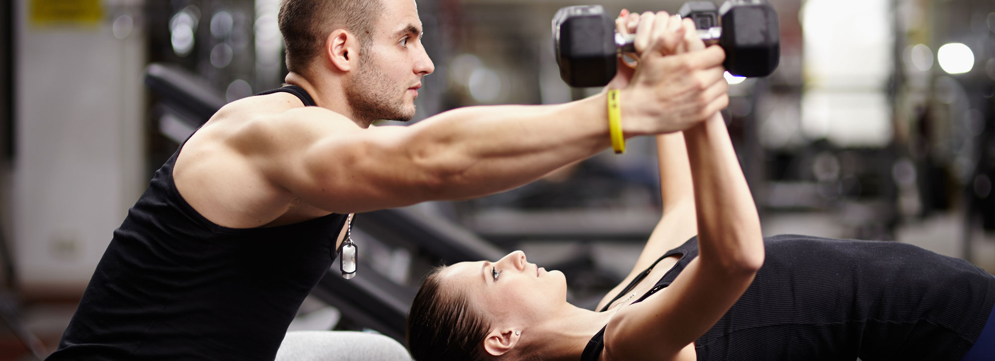 Woman Lifting Weights, Aided by a Man